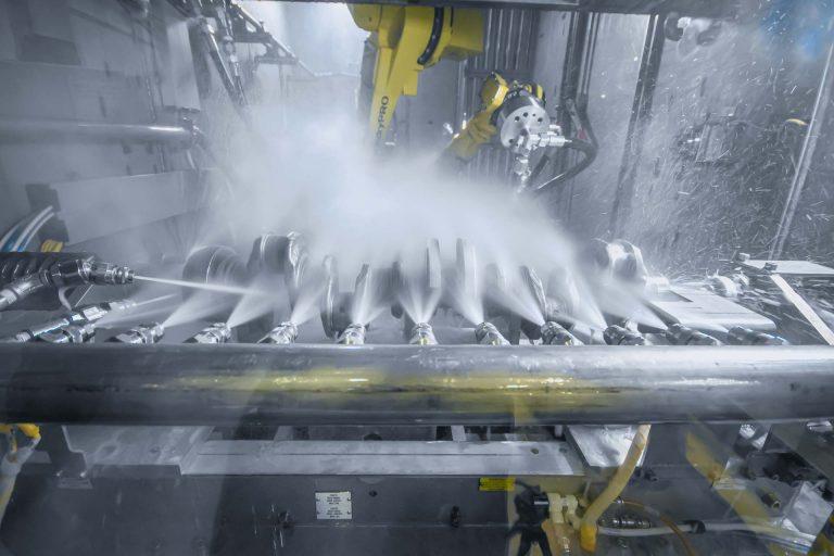 Valiant TMS - Automotive Powertrain - Crankshaft - ValuFlex® Robotic Flexible Washer - Wash Station with Water Hammer Nozzle